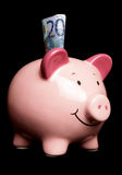 Twenty euros in a piggy bank royalty free stock image