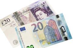 Twenty Euros and Twenty Pound Notes. British European exit (Brexit) concept of twenty Euro and Pound note isolated on a white background to illustrate the impact Royalty Free Stock Photo