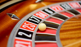 Twenty five roulette. Number twenty five at the roulette wheel in casino close up details stock image