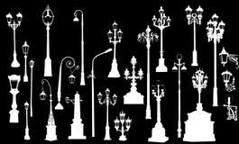 Twenty five white street lamps Royalty Free Stock Image