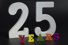 Twenty-five years. Twenty-five years in large white numerals on a black background Royalty Free Stock Image