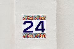 Twenty four. Decorative house number twentyfour at ceramic tiles Royalty Free Stock Photography