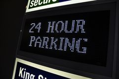 24 twenty four hour car park sign. 24 twenty four hour car parking street sign in a busy city. Under cover car parking Stock Image