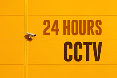 Twenty four hours cctv camera. Mounted on the wall of industrial building Stock Photos
