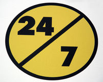 Twenty Four/Seven. Road sign indicating twenty four hours per day, seven days per week Royalty Free Stock Photography