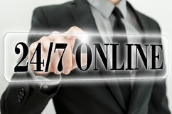 Twenty four seven online. 24/7 online button on virtual screen Royalty Free Stock Photography