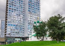 Twenty-four storey residential building and the Church of Simeon. Moscow. Twenty-four storey residential building and the Church of Simeon. New Arbat Street Stock Photo
