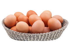 Twenty fresh chicken eggs in wicker basket Royalty Free Stock Image