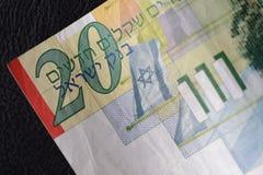 Twenty Israeli shekels on a dark background Royalty Free Stock Images