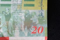 Twenty Israeli shekels on a dark background Stock Image