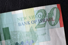 Twenty Israeli shekels on a dark background Stock Image