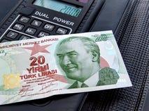 Twenty Lira. On calculator memo pad Royalty Free Stock Photography