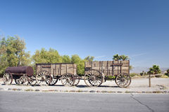 Twenty-mule team wagons. Side view of old twenty-mule team wagons used for ferrying borax in nineteenth century, Death Valley National Park, America Royalty Free Stock Photos