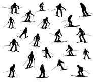 Twenty one skiers. Twenty one silhouette of skiers. Downhill racing, a snowboard, children and teenagers in movement Royalty Free Stock Photo