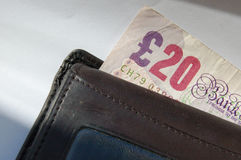 Twenty Pound Note. A twenty pound note emerging from a wallet stock photos