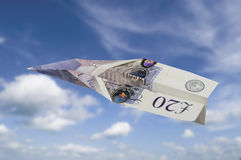 Twenty pound note plane Stock Photography