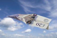 Twenty pound note plane Stock Photography