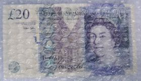 Twenty Pound Note Under Bubble Wrap Royalty Free Stock Photo