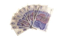 Twenty Pound Notes. British twenty pound notes in fan or resembling hand of cards. The notes feature the image of Adam Smith Royalty Free Stock Photography
