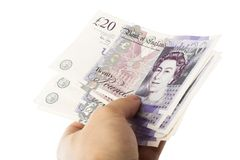 Twenty pounds in hand Royalty Free Stock Image