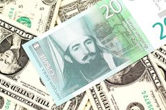 A twenty Serbian dinar with American one dollar bills. A close up of a green and white, twenty Serbian dinar bank note on a background of American one dollar royalty free stock photography