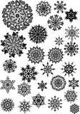 Twenty seven black snowflakes Royalty Free Stock Photos