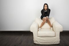 Young woman on couch stock photos