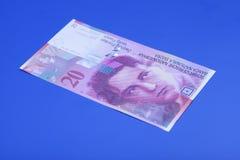 Twenty Swiss Franc note. On blue background royalty free stock photography