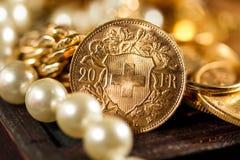 Twenty Swiss Francs coins. Twenty Swiss Francs gold coins - Selective focus Stock Photography