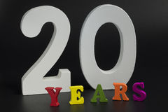Twenty years. Twenty years of large white numerals on a black background Stock Images