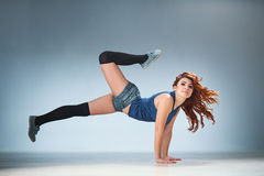 Twerk redhead woman in jeans shorts royalty free stock photo
