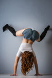 Twerk redhead woman in jeans shorts Stock Photos