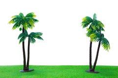 Twic zabawkarski kokosowy drzewo na trawie z odosobnionym białym tłem Zdjęcia Stock