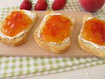 Twice-baked bread with peach-strawberry-jam Stock Photo