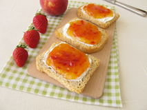 Twice-baked bread with peach-strawberry-jam Royalty Free Stock Photo