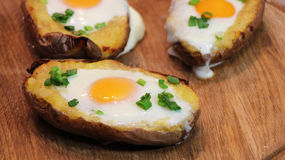 Twice baked potato. Potato baked with cheese, green onion and egg Stock Photo
