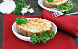 Twice Baked and Stuffed Garlic Potatoes Stock Photo