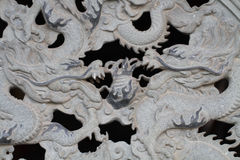 Twice dragon marble carving wall, Decorative Chinese art style at Chinese public temple Royalty Free Stock Image