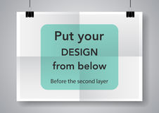 Twice a folded poster with clamps. Royalty Free Stock Photography