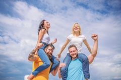 Twice fun on double date. Couples in love having fun. Men carry girlfriends on shoulders. Summer vacation and fun. Couples on double date. Inviting another stock image