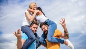 Twice fun on double date. Friendship of families. Couples in love having fun. Men carry girlfriends on shoulders. Summer. Vacation and fun. Couples on double royalty free stock photos
