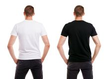 Twice man in blank white and black tshirt from back side on white background stock photos