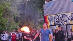 Twice spew fire. PERM, RUSSIA - JUN 7, 2015: Twice spew fire. Open rehearsal of fire-eaters stock video footage