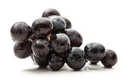 Twig of black grape Stock Image