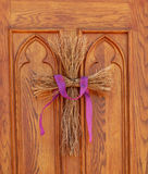 Twig cross on church door Stock Photography