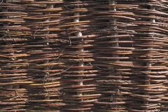 Twig fencing. Close-up of wattle fence made from sticks and twigs royalty free stock photography