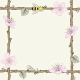 Twig frame with flowers and bee Royalty Free Stock Photography