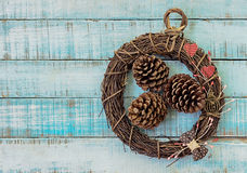 Twig wreath with paper hearts, vintage furniture and fircones on Stock Photo