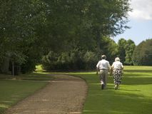 Twighlight years. Old couple enjoying a countryside walk royalty free stock photos