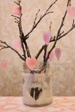 Twigs decorated with hearts in the jar Royalty Free Stock Photography